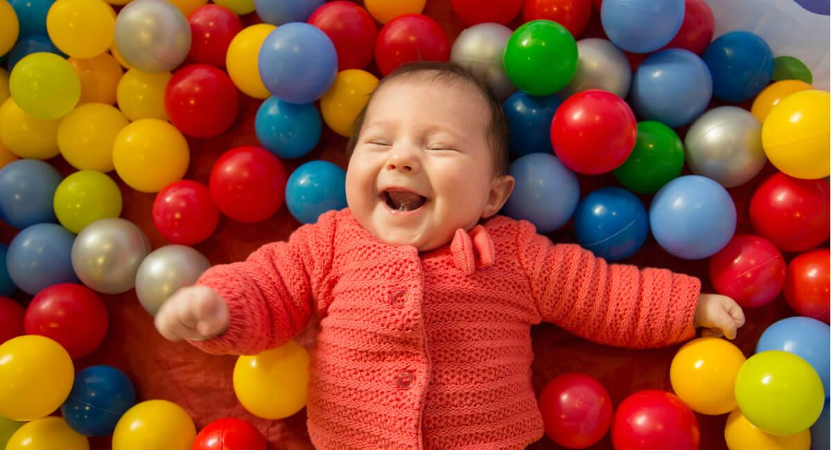 baby using senses in coloured balls