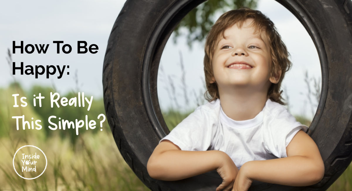 Child being happy in old tire