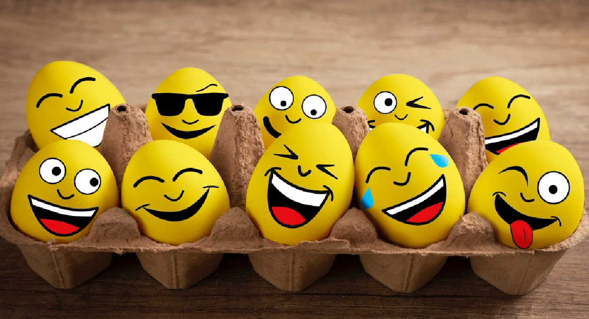 painted funny eggs in a box